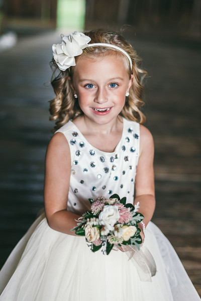 A smiling flower girl prior to the wedding ceremony.