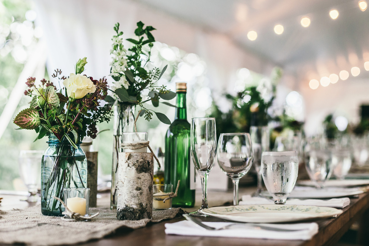 Rustic decor along with vintage table ware adorn the wedding guest tables.