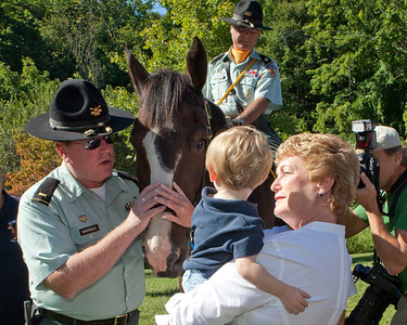 Governor Rell brought along her grandson. He didn't know what to make of a horse.