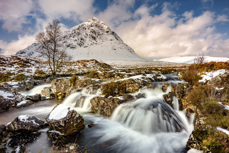 Buachaille Etive Mor Waterfall Covered In Snow. Glencoe, Scotland.