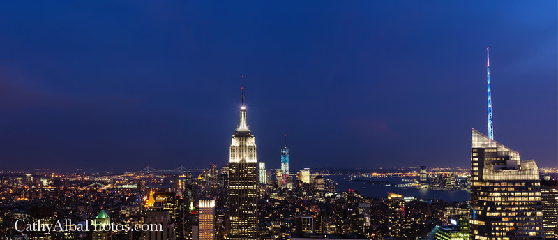 The night sky and blue hour. A beautiful Panoramic view of New York City from the 70th floor observation deck of the Top of the Rock with the Empire State Building and the Freedom Tower in the distance. I staked out my spot for 2 hours to make sure I had a spot on the wall to stabilize my camera since tripods are not allowed.<br /> <br /> This is a  2 shot pano stitched together for a wider view of the skyline.<br /> <br /> Thank you for stopping by and taking a look at my photography. <br /> <br /> Watermarks do not appear in final products