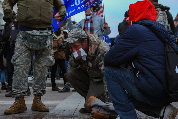 A demonstrator at the U.S. Capitol reels from the effects of chemical agents after a confrontation with police
