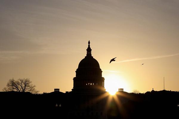 Sunrise behind U.S. Capitol