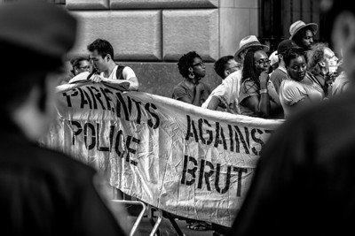 Parents Against Police Brutality being watched by the police.