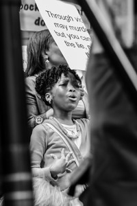 Young Girl protests killing of Ramarley Graham, Bronx Courthouse, August 2013