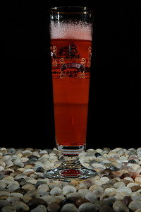 A solitary beer glass on a rock surface.