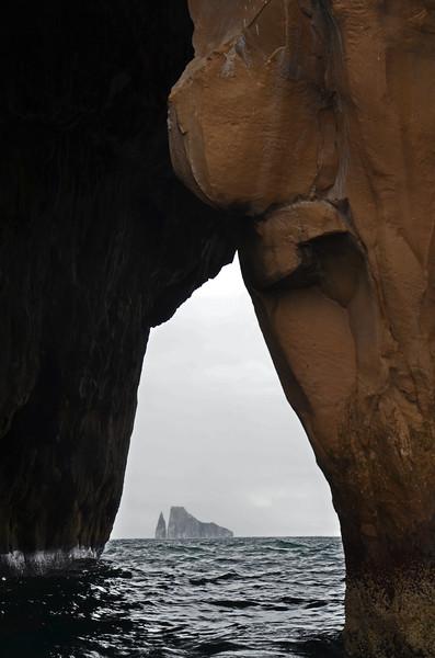 León Dormida framed by cave at Cerro Brujo, San Cristóbal