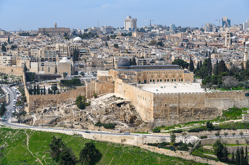 Corner of the Temple Mount with the ruins of the City of David in front of modern Jerusalem.