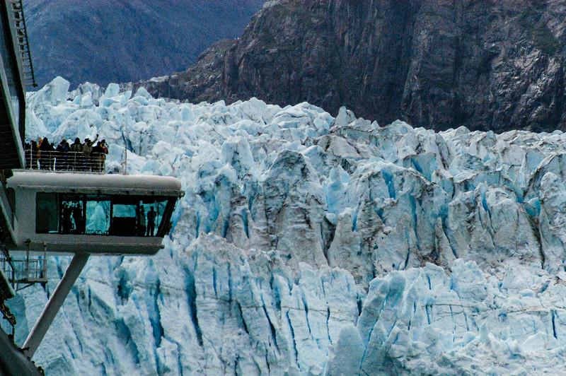 Glacier at Waters Edge Towering Over Bridge Wing