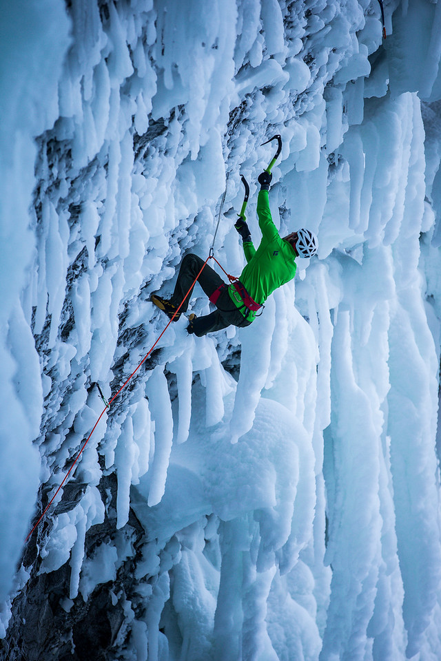 "Klemen Premrl climbing a first ascent on ""Clash of the Titans""  at Helmcken Falls in Wells Gray Provincial Park, Canada, BC. © Christian Pondella"