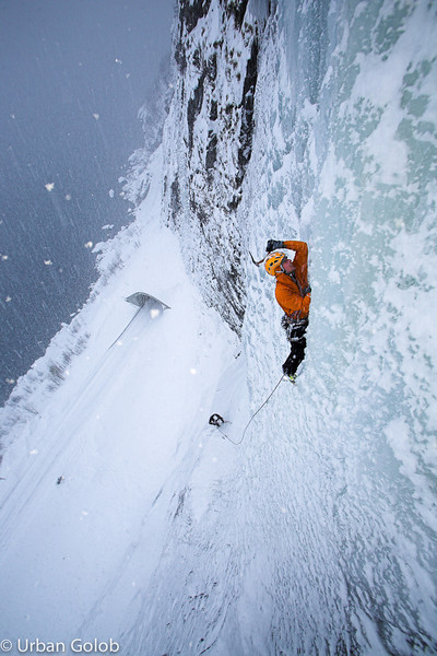 "NORWAY / Troms / Senja Island / Senja Island / The weather on the Arctic ocean facing Senja Island is quite unpredictable and unstable. There is a lot of snowfall, storms, high winds and very low temperatures during the hard winter. Here, climber Klemen Premrl climbs the ""Arctic ocean"" icefall just above the sea in such really unpleasant weather. <br /> <br /> © Urban Golob / Anzenberger"