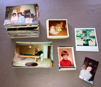 sized piles of snapshots