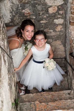 The bride climbs the stairs