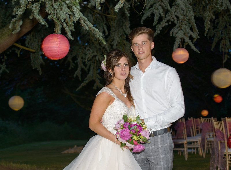 bride and groom surrounded by lit lanterns