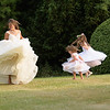 the bride having fun with the flower girls