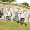 The groomsmen jump for joy