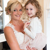 the bride and a little girl share a moment