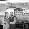 The bride and Groom in front of the carousel