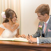 signing the register of marriages