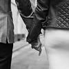 birde and groom hold hands