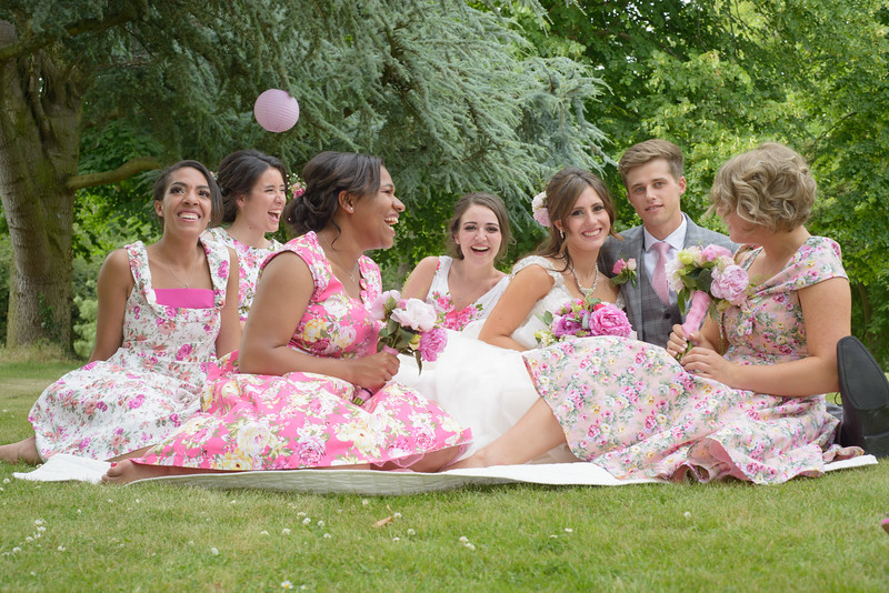 the bridesmaids chill out with the happy couple