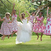 the bridesmaids jump for joy