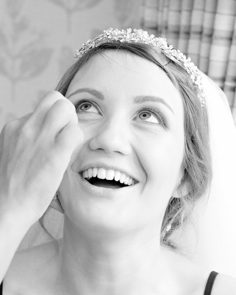 The final touches of make up for the bride