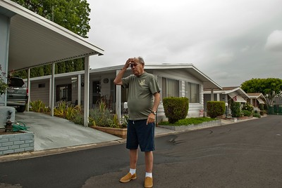 Man holding his head, A modular home park in Whittier California.