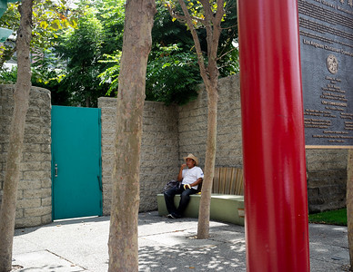 A man sitting on a bench in China Town, Los Angeles CA,.