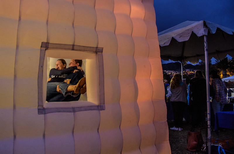 A couple enjoys a photo booth at a carnival in Malibu CA.