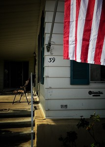 An American flag,  in front of a home in Whittier California.