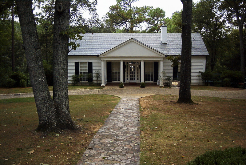 """Franklin Delano Roosevelt built the Little White House in 1932 while governor of New York, prior to being inaugurated as president in 1933. He first came to Warm Springs in 1924 hoping to find a cure for the infantile paralysis (polio) that had struck him in 1921. Swimming in the 88-degree, buoyant spring waters brought him no miracle cure, but it did bring improvement. During FDR's presidency and the Great Depression, he developed many New Deal Programs (such as the Rural Electrification Administration) based upon his experiences in this small town.<br /> <br /> While posing for a portrait on April 12, 1945, FDR suffered a stroke and died a short while later. Today, the """"Unfinished Portrait"""" is featured in a museum that showcases many exhibits, including FDR's 1938 Ford convertible with hand controls, his Fireside Chats playing over a 1930s radio, his stagecoach and a theater. Visitors can tour FDR's home, which has been carefully preserved very much as he left it, the servants and guest quarters, and the nearby pools complex that first brought the future president to Warm Springs. Selected as a """"Readers Choice"""" site in Georgia Magazine four years in a row."""