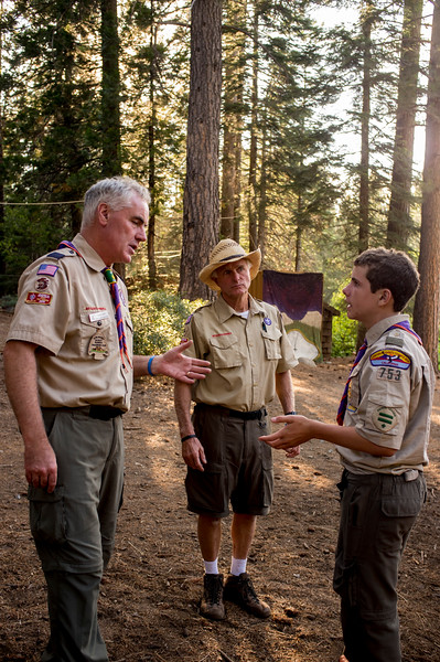 A boy scout has a conference with the headmaster.
