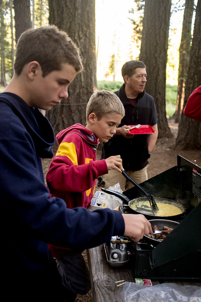 Boy Scouts cooking breakfast for fellow campers.