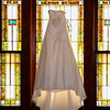 Bridal Gown Hanging In Stained Glass Windows<br /> At Perry Baptist Church in Perry, MO