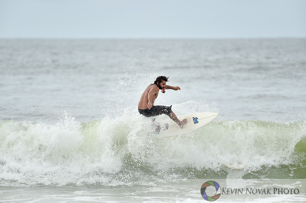 Panama City Beach, FL.  September 29, 2015. Surfing action,  Panama City Beach County Pier.  © 2015 Kevin Novak