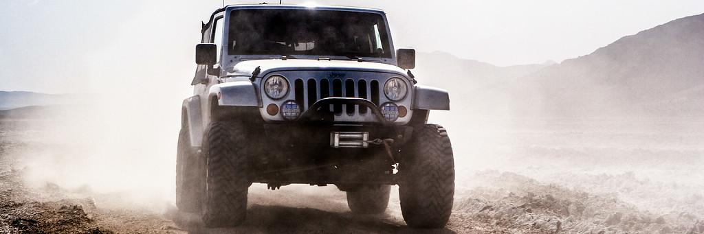 Bill driving my jeep across Soda Dry Lake so I can shoot.