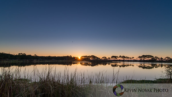 Sunrise, Gator Lake, St. Andrews State Park.  ©2015 Kevin Novak.
