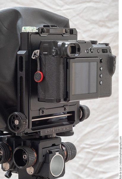 Fuji GFX 50R attached in landscape orientation. There is plenty of room between the front of the camera and the camera board for my fingers to reach the front function button and the lens release button. It's possible to mount the camera even closer to the board, but that makes using the buttons impossible without a tool.