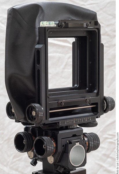 """The rear standard has a square opening with rounded corners that mounts the """"camera board"""". Notice the twin bubble levels. Sliding and stationary adapter boards for medium format backs were available."""