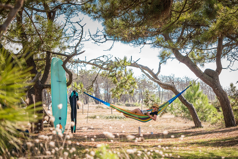 Woman resting in her hammock after surf