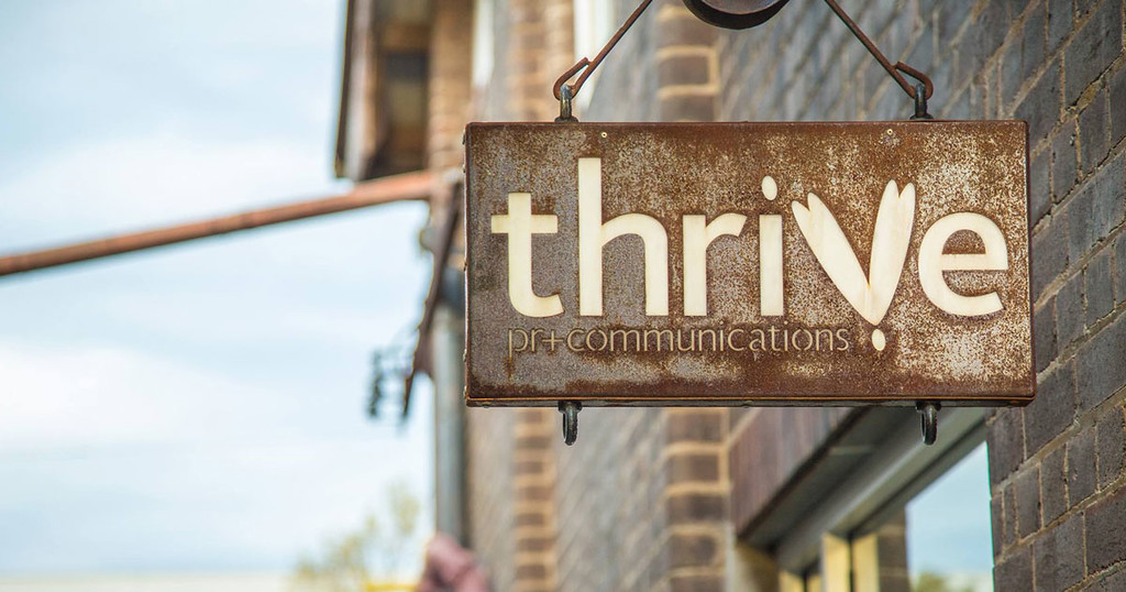 Thrive PR + Communications logo
