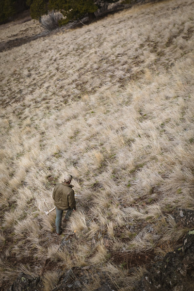 Sam Averett (@samaverett) retrieving an elk antler in Oregon.