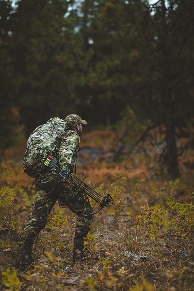 Austin Heinrich heading uphill on a rainy morning in Idaho while pursuing elk.