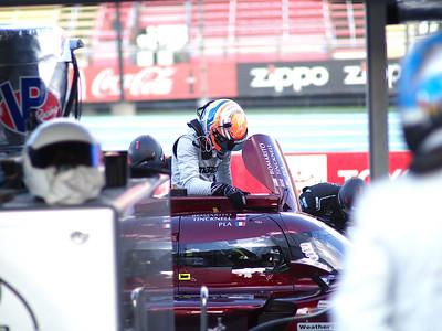 Mazda #55 Harry Tincknell enters the cockpit.