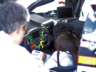 #6 Penske Acura driver Juan Montoya showing his office to one of his daughers.