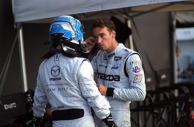 Mazda #55 drivers plan race strategy.