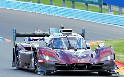 Mazda #77 warms up for qualifiying lap.