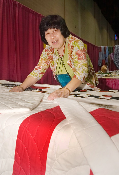 Alice K.  Murata, Ph.D. , From Northeastern Illinois University. with a Japanese Quilt made to look like a Kimono as an example of Japanese American quilting.