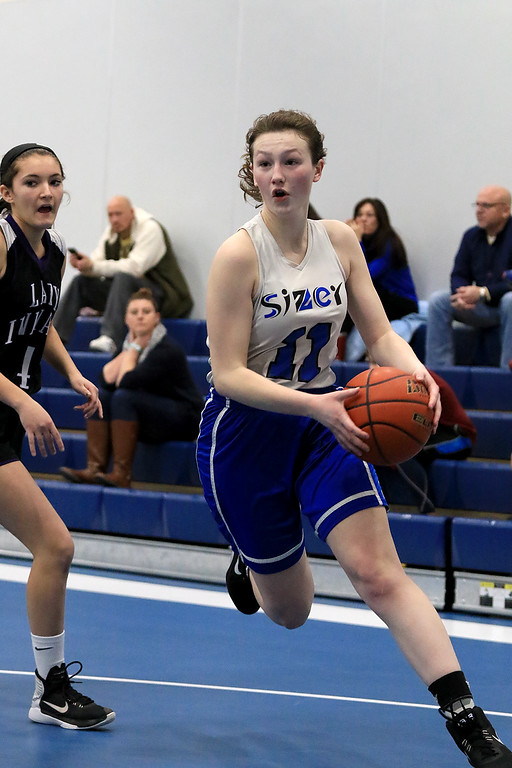 . North Brookfield High School girls basketball played The Sizer School in Fitchburg on Friday afternoon, February 15, 2019. Sizer\'s Claire Petersen drives to the basket. SENTINEL & ENTERPRISE/JOHN LOVE